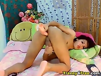 Asian Tranny Penetrates Her Ass