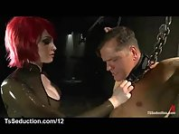 Busty redhead tranny fondles bound guy in secret dungeon