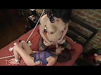 Tied up brunette face fucked by tranny